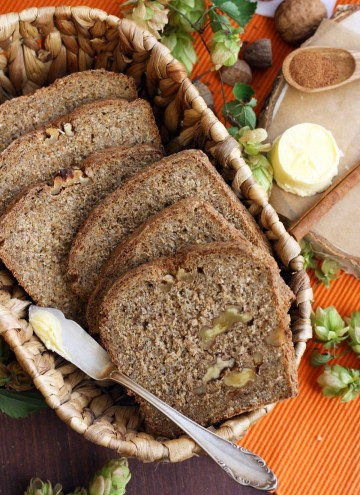 Healthy Pumpkin Bread with Walnuts in a Cute Basket with Butter and Spices