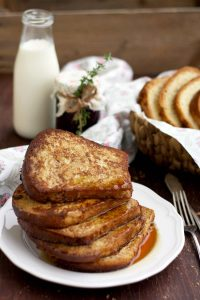 Healthier Brioche French Toast On the Table with Milk and Lots of French Toasts