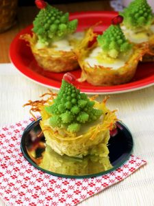 Christmas Tree Mini Quiches on the Table with Festive Napkins