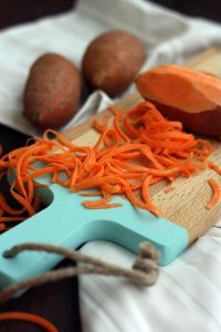 Healthy Sweet Potato Noodle Salad with Chickpeas and Rocket - Preparing Carrot Closeup
