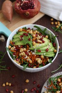 Healthy Sweet Potato Noodle Salad with Chickpeas and Rocket with Pomegranate Seeds Around the Bowl