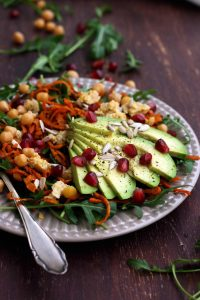 Healthy Sweet Potato Noodle Salad with Chickpeas and Rocket with Lots of Ingredients Around the Plate.