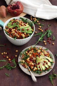 Healthy Sweet Potato Noodle Salad with Chickpeas and Rocket - Served in a Bowl and a Plate with a Pomegranate on the Side