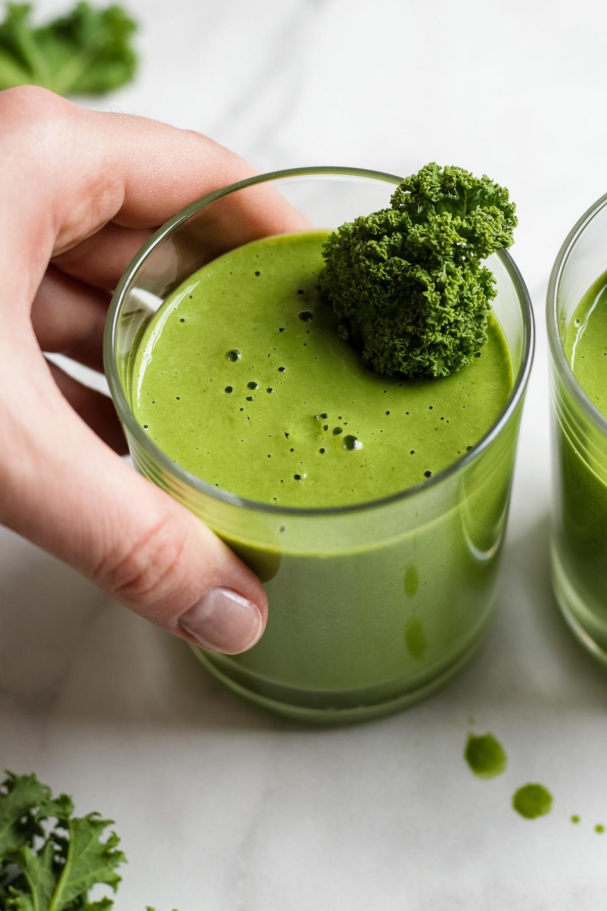 Vegan Green Smoothie Garnished with Kale.