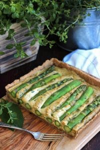The Best Vegan Quiche Ever Served on the Wooden Tray with One Fork Next to It