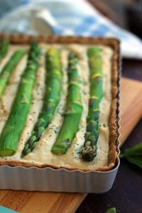 The Best Vegan Quiche Ever Closeup on Asparagus and the Corner fo the Tray