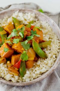Easy and wholesome Vegetarian Red Curry Stir Fry Recipe makes for a nutritious weeknight dinner ready in just 30 minutes! It's also vegan, gluten free and paleo, not to mention flavorful and easy to make! @elenaszeliga from @happykitchen.rocks