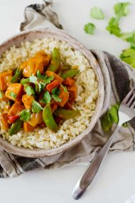 Vegetarian Red Curry Stir Fry - a Bowl Full of Stir Fry with a Fork Next to It and a Cloth Beneath