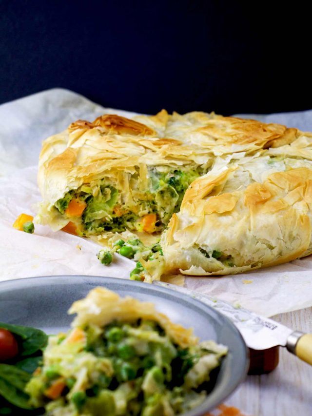 Broccoli vegetarian pot pie filled with colourful veggies, smooth béchamel with a nutty flair, enveloped in a flaky filo crust.