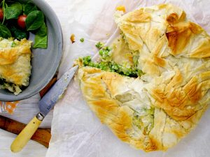 Healthy Vegetarian Pot Pie Missing a Piece with a Knife