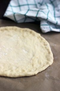 Foolproof Step-by-Step Homemade Pizza Crust Recipe: The only pizza crust recipe you'll ever need. Quick, easy, delicious and so much healthier than store-bough