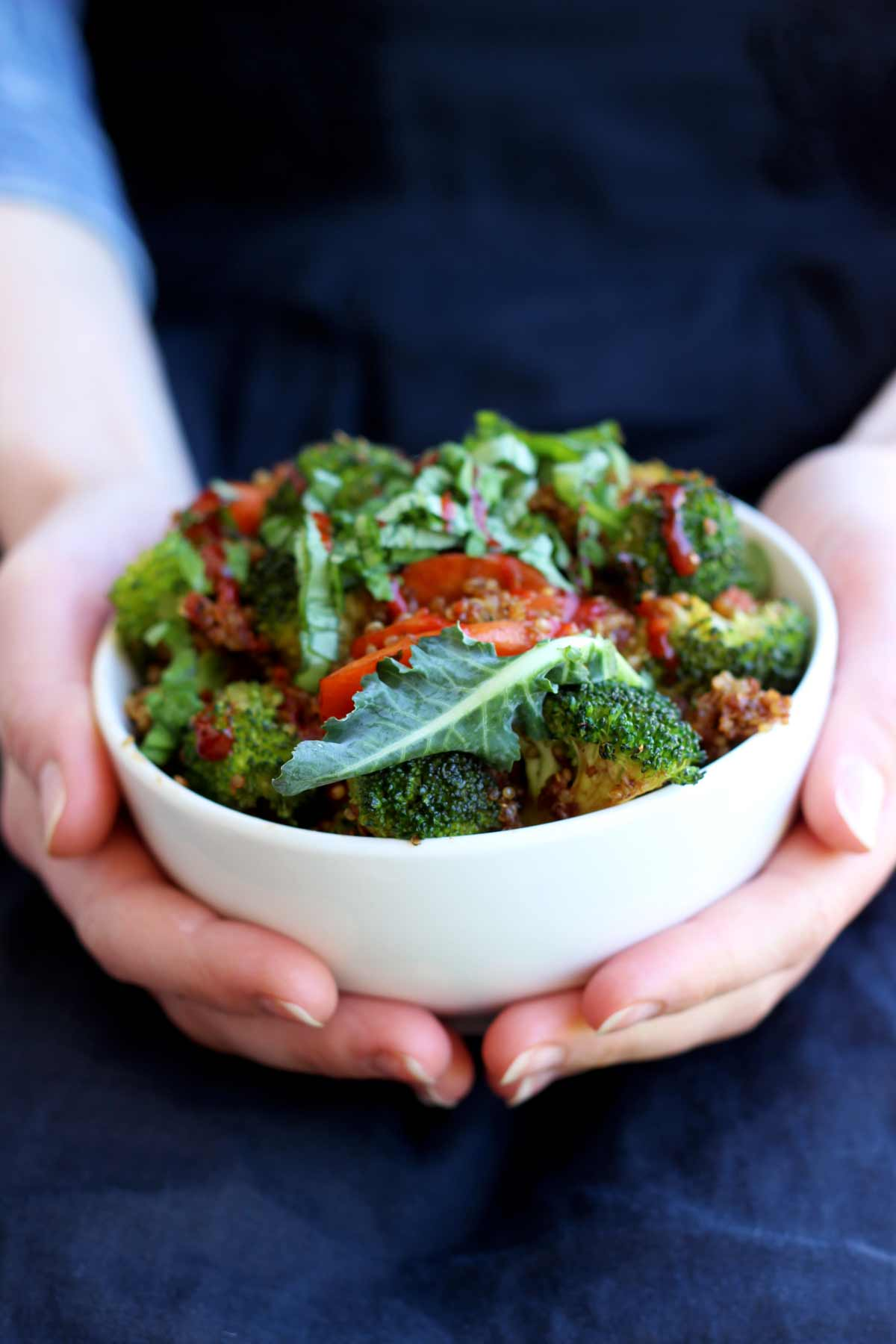 Simple Vegan Quinoa Fried Rice - Holding in Hands in a White Bowl