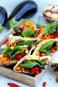 Pita Pockets with Roasted Veggies and Hummus - Fantastic Composition with Some Fresh Veggies Blurred in the Background