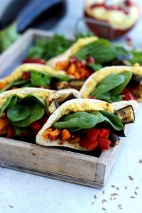 Pita Pockets with Roasted Veggies and Hummus Arranged in a Small Wooden Tray - Another Angle