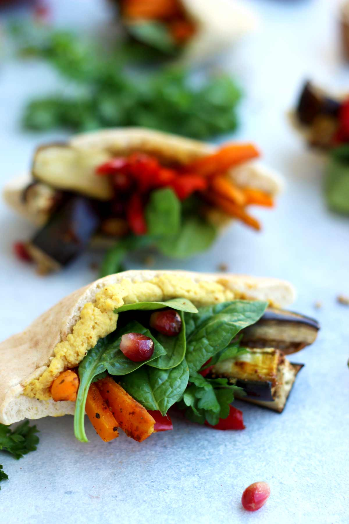 Pita Pockets with Roasted Veggies and Hummus Beautiful Closeup on One of the Pitas on the Table
