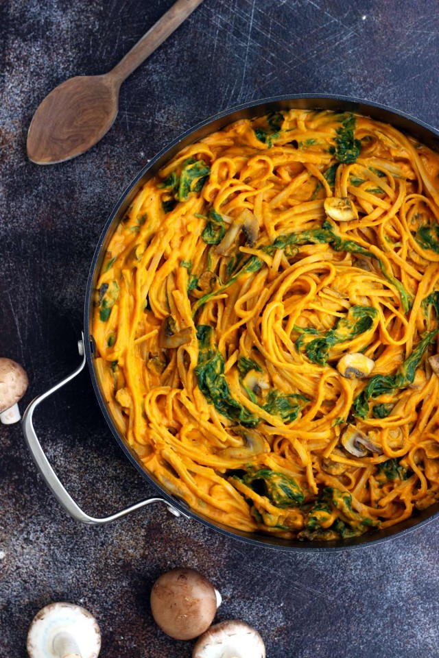 Pumpkin Pasta with Spinach and Mushrooms in a Skillet