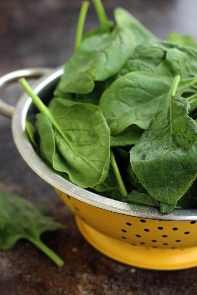 Fresh Spinach in a Yellow Sieve
