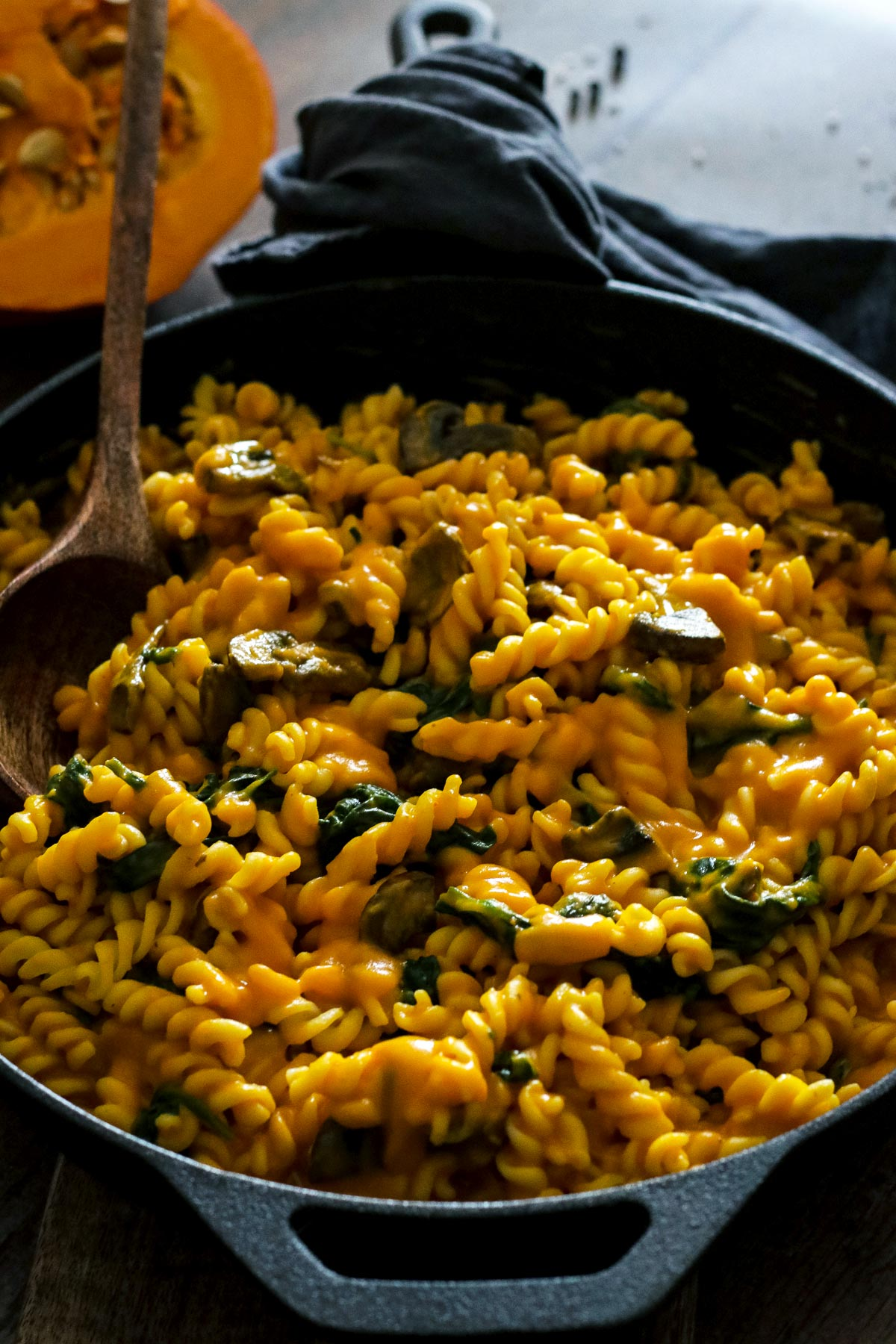 Pumpkin Pasta with Mushrooms and Spinach in a Skillet.