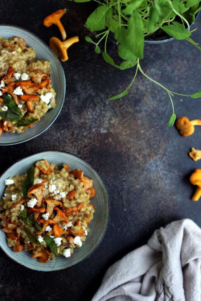 Easy Barley Risotto with Mushroom and Goat Cheese in Bowls Flatlay - Negative Space