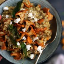 Easy Barley Risotto with Mushroom and Goat Cheese in a Bowl Flatlay Closup with a Spoon in the Bowl