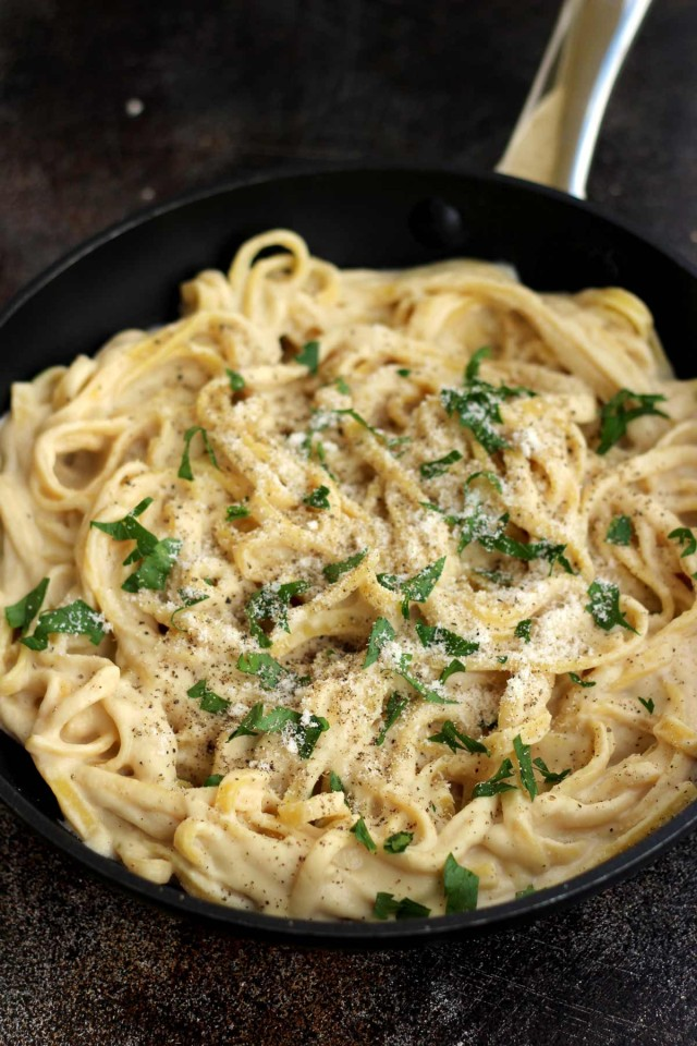 The Creamiest Vegan Fettuccine Alfredo - Garnished and Ready to Be Served