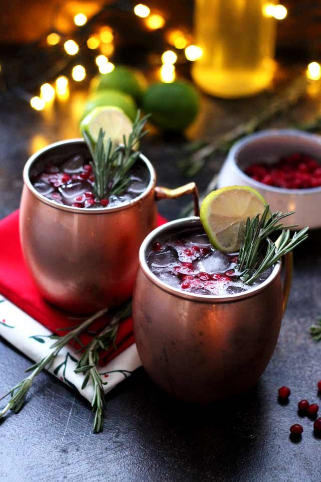 Moscow Mule Served in Copper Mugs with Lights in the Background.
