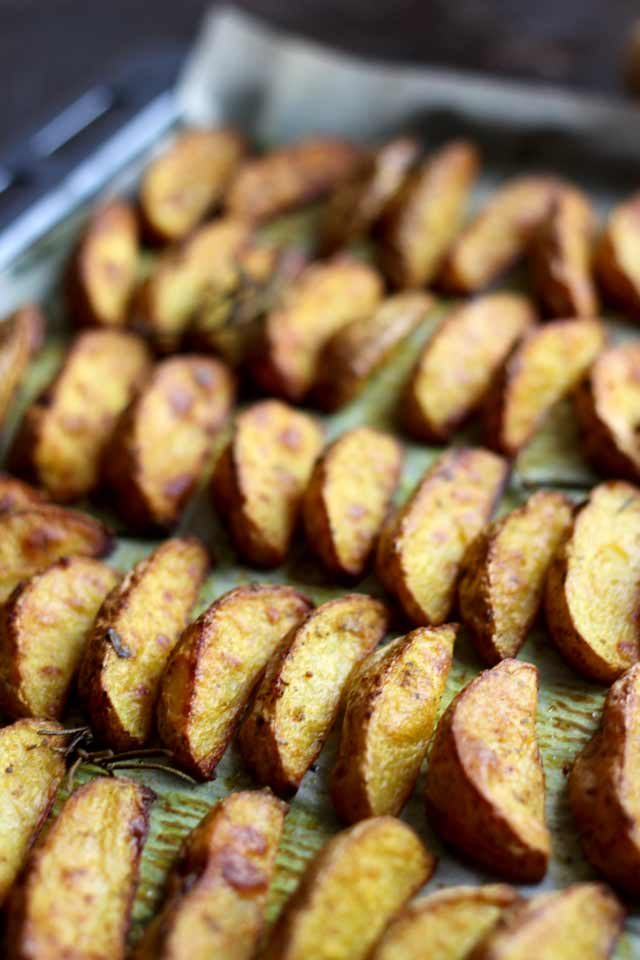Easy Baked Potato Wedges Assembled in Lines and Looking Delicious