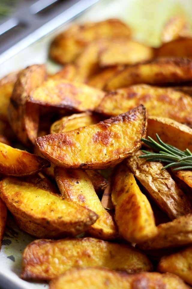 Easy Baked Potato Wedges Decorated with Rosemary Sprigs