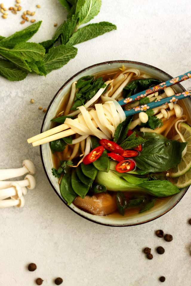 Vegan Pho (Phở) is an easier and healthier version of the traditional Vietnamese noodle soup. This nourishing and flavorful gluten-free and fat-free soup is perfect for any season!