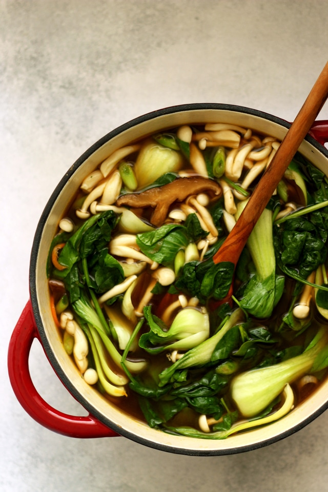 Easy Vegan Pho (Vietnamese Noodle Soup) in a Pot with a Ladle Overhead