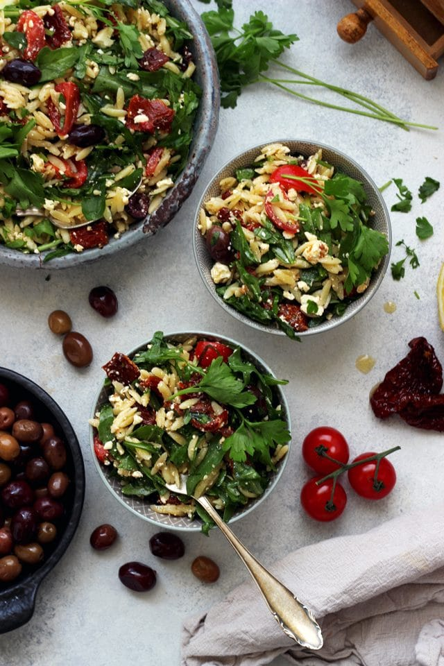 This easy Greek Orzo Salad is perfect for picnics, potlucks, BBQ and get togethers. Whenever you need an easy and healthy side dish, that is guaranteed to disappear first, make this gorgeous Greek orzo salad!
