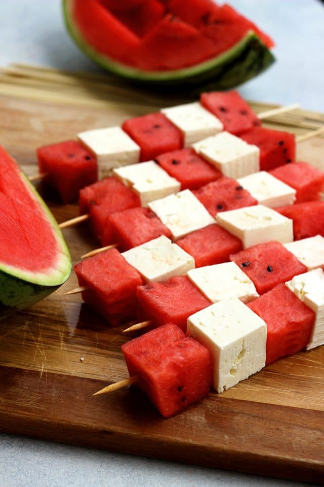 These take-along watermelon skewers with feta and mint pesto dressing are a quick and easy appetizer or snack for your next outdoor gathering, BBQ or picnic! Enjoy these delicious and healthy watermelon skewers on a hot summer day!