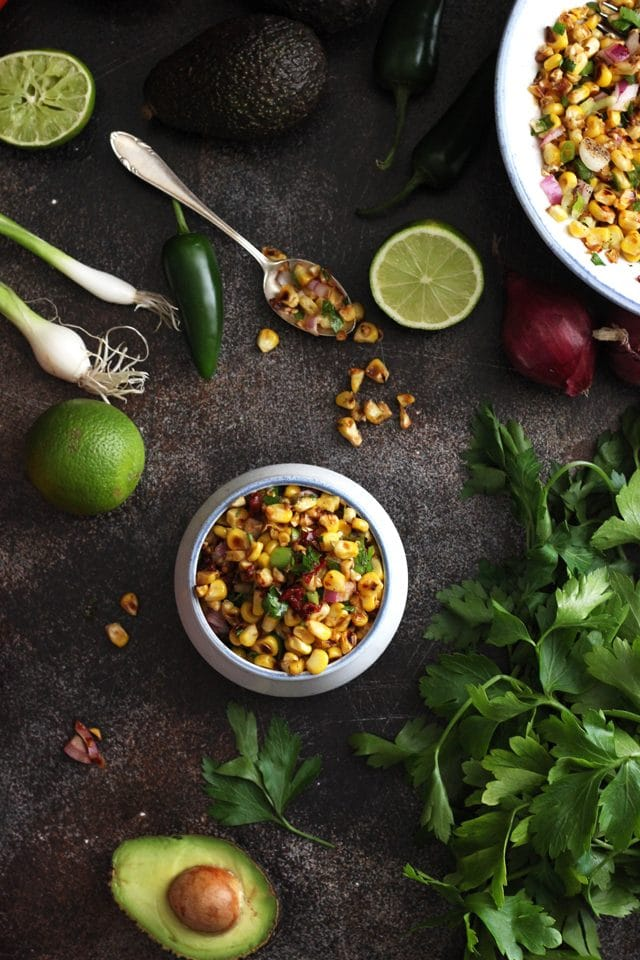 This addictive Chipotle Corn Salsa is a perfect accompaniment to any Mexican food. Sweet roasted corn makes a perfect pairing with smoky chipotle peppers. Such an amazing and fresh side dish recipe for summer gatherings!