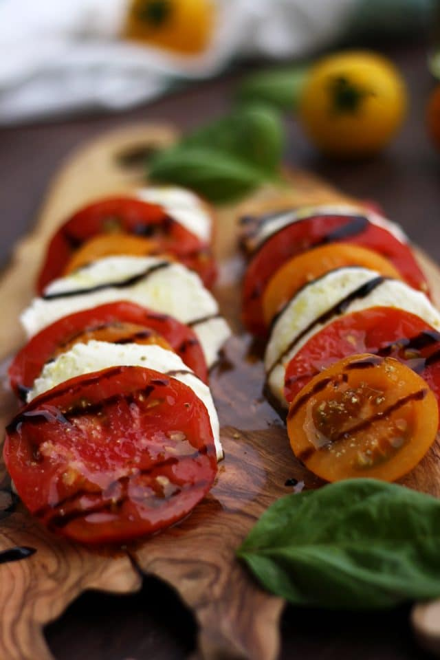 Classic Insalata Caprese (Tomato Mozzarella Salad) is the perfect quick appetizer or salad packed with summer flavors! Light, refreshing and so easy to make! A great way to enjoy in-season tomatoes at the fullest.