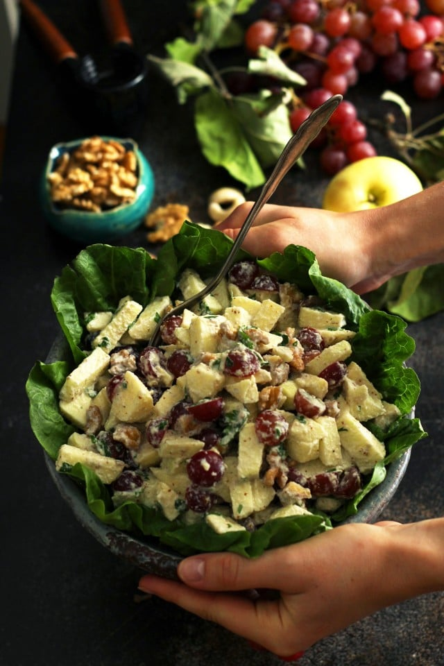 Healthy Vegan Waldorf Salad Recipe - Hands Holding a Bowl above the Table