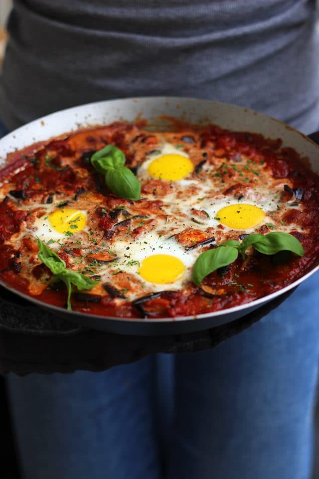 The Best Shakshuka Recipe - Holding the Incredible Pan Full of Shakshuka in Hands