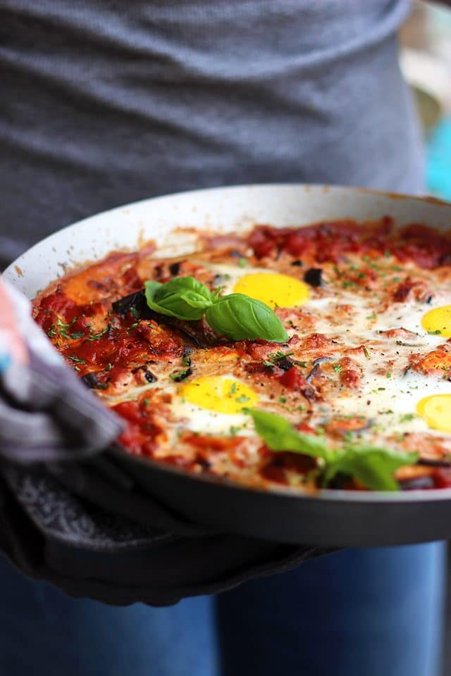 Foolproof Shakshuka Recipe: Eggs poached in spicy tomato-based veggie stew, baked to perfection, garnished with fresh herbs and served with crusty bread. Flavorsome, nourishing and healthy one-pot breakfast or dinner meal you will make over and over again!