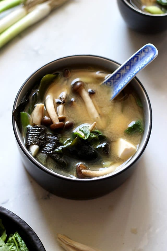 Easy Miso Soup (Japanese Clear Soup) - Closeup on a Bowl Full of Mushrooms and Other Delicious Ingredients