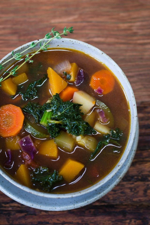 Fall Harvest Soup with carrots, butternut squash and kale in a bowl.