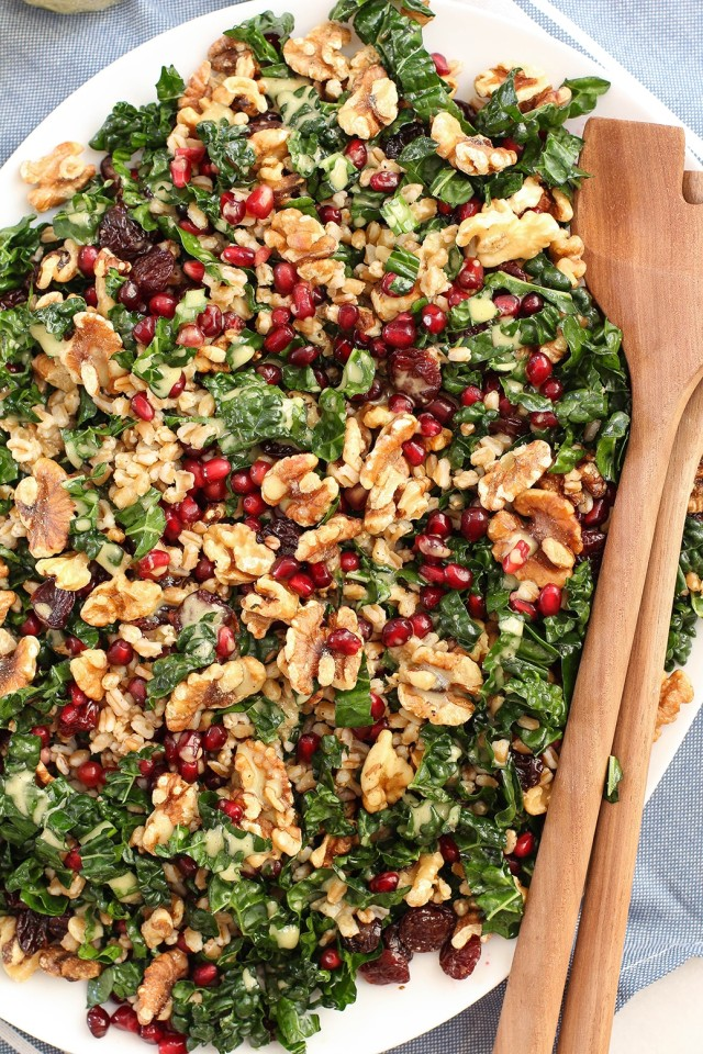 Fall Kale Farro Salad in a large plate with utencils.