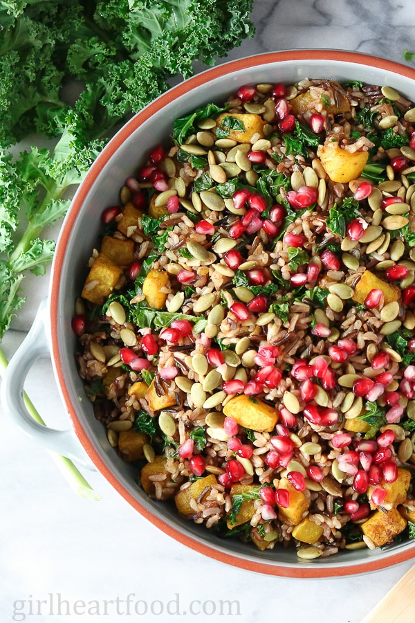 Harvest Wild Rice Salad garnished with pomegranate seeds.