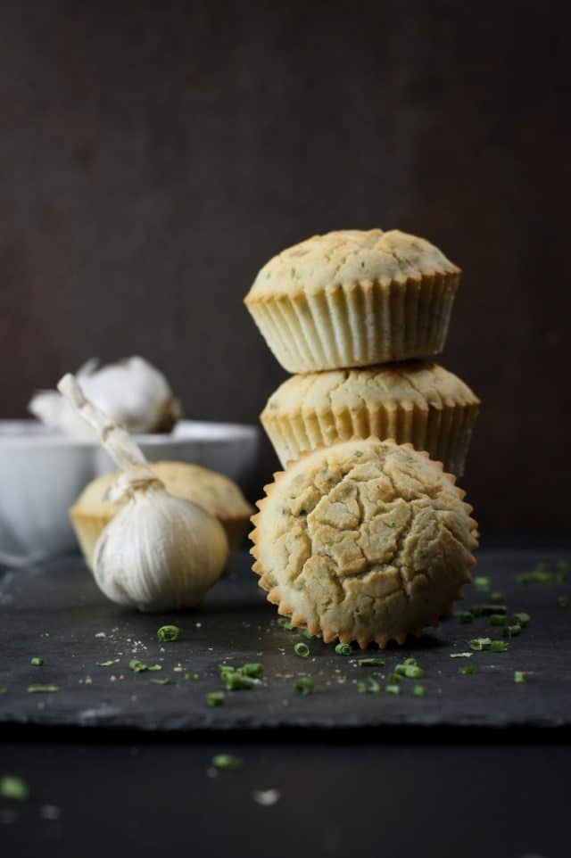 These garlic and chive dinner muffins have an incredible texture that is really light, soft and fluffy. They are delicious on their own or great served with soup or stews. These would even be delicious served with a lentil loaf!