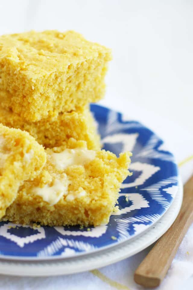 Light and fluffy vegan cornbread is perfect when smeared with vegan buttery spread. Serve this alongside your favorite chili recipe!