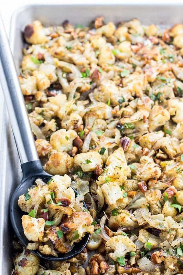 Need an easy low carb paleo stuffing for Thanksgiving? Try this cauliflower stuffing recipe! It has all the same flavors, plus it's healthy and delicious.