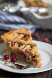 A Slice of Gingerbread Apple Cranberry Vegan Pie with Lattice Crust.