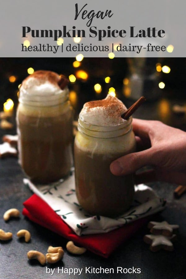 Healthy Vegan Pumpkin Spice Latte - Holding One Mason Jar with Lights in the Background