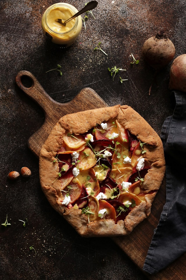 Beet Galette with Goat Cheese on a Wooden Board Flatlay