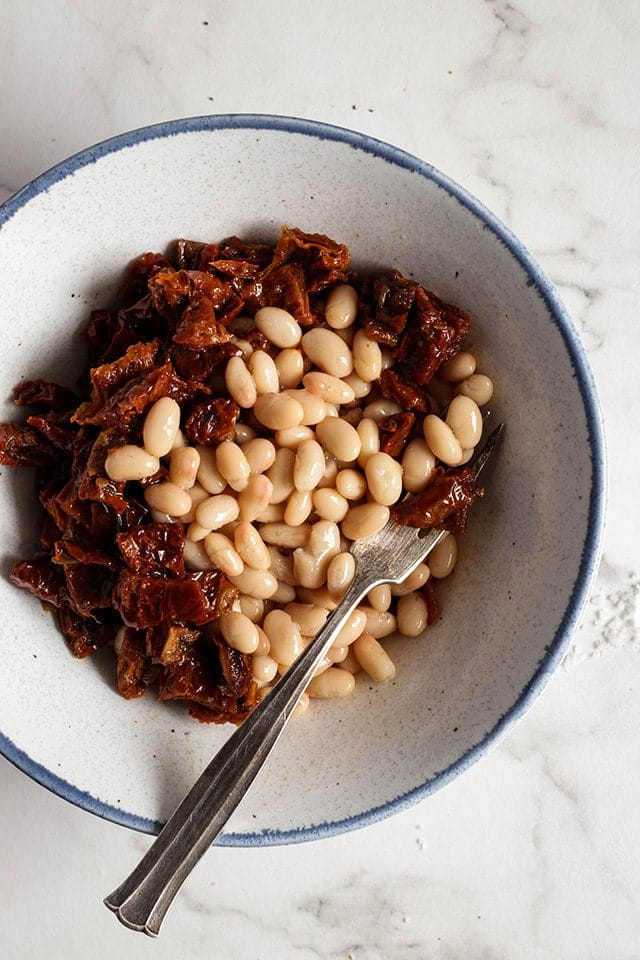 Sun-dried tomatoes and cannellini beans in a bowl