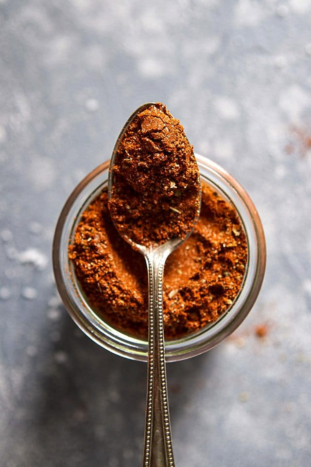 Spoonful of DIY Taco Seasoning on a Jar