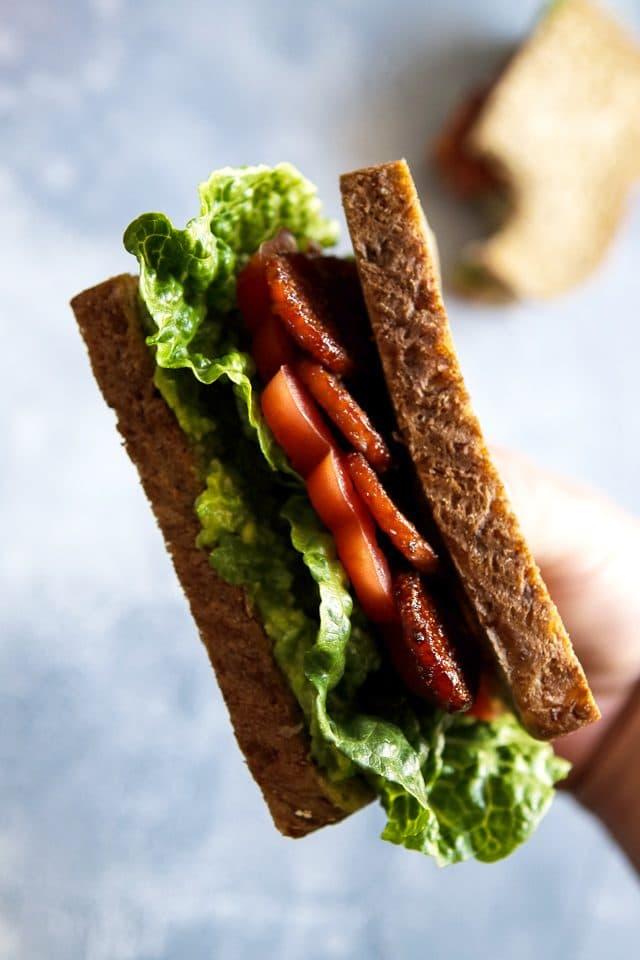 Hand Holding a Vegan BLT Sandwich